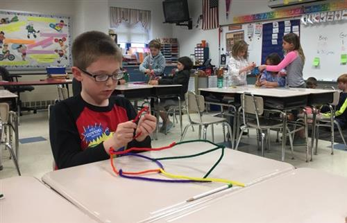 Student Working With Pipe Cleaners