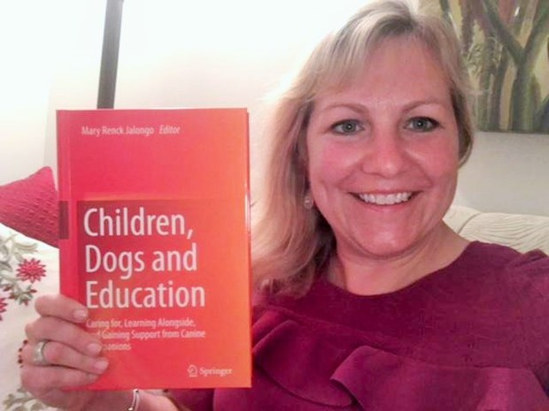 Wellsville Principal Contributes to Book on Service Dogs